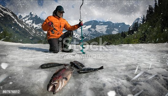 istock Fishing. Ice fishing background. 897976512
