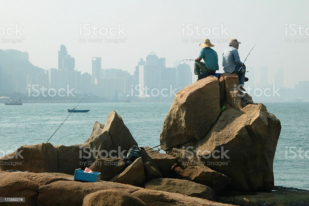 Fishing in a city royalty-free stock photo