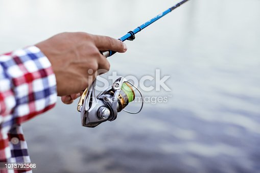 115874504istockphoto Fishing in the river at sunset. 1013792566