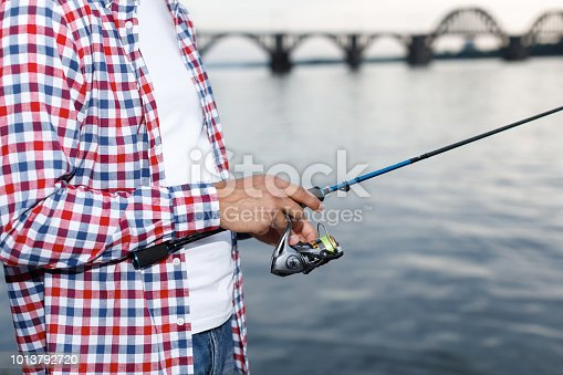 115874504istockphoto Fishing in the river at sunset. 1013792720