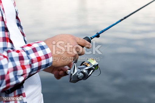 115874504istockphoto Fishing in the river at sunset. 1013792904