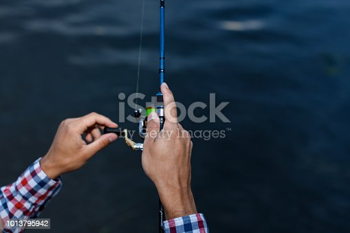 115874504istockphoto Fishing in the river at sunset. 1013795942