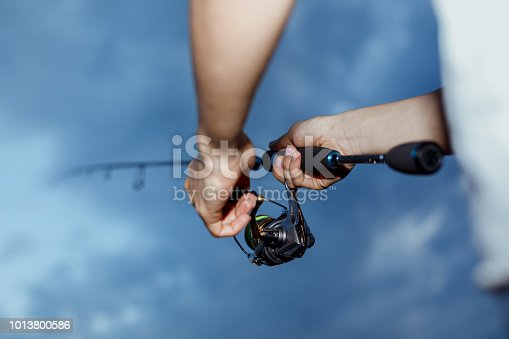 115874504istockphoto Fishing in the river at sunset. 1013800586