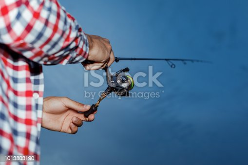 115874504istockphoto Fishing in the river at sunset. 1013803190