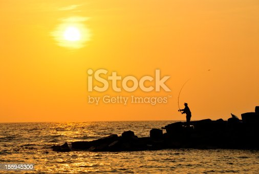 istock Fishing in the sunset 155945300