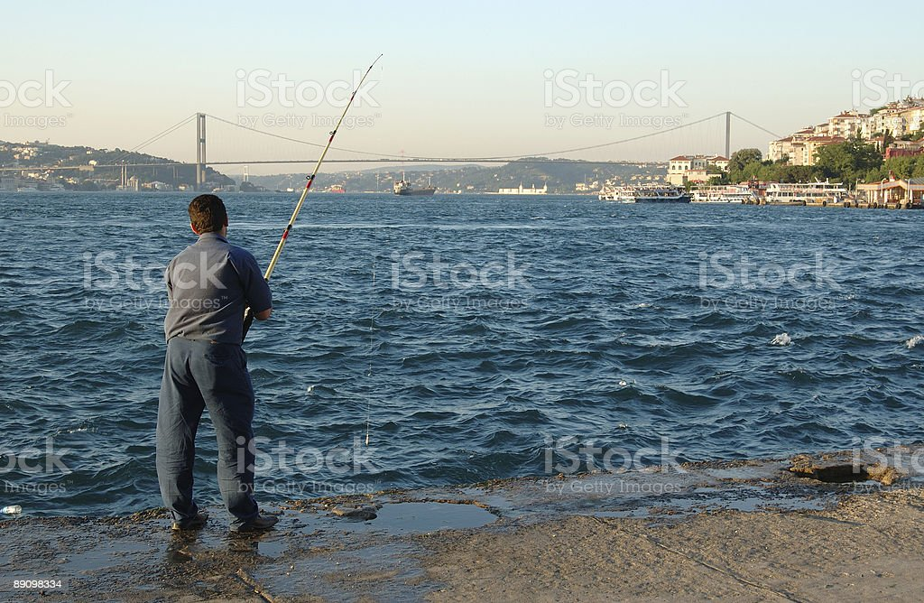 Fishing in Turkey between Europe and Asia royalty-free stock photo