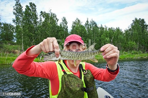 914030378istockphoto Fishing is a great catch. Caught fish in the hands of a happy fisherman 1143084553
