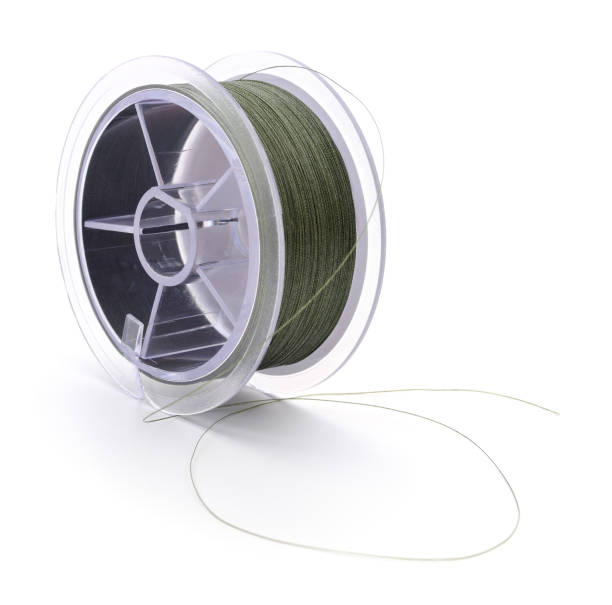 Fishing line isolated on white. A spool of fishing line isolated on white. fishing line stock pictures, royalty-free photos & images