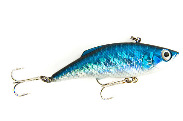 fishing lure blue fishing lure (wobbler) isolated on white background, close-up fishing hook stock pictures, royalty-free photos & images