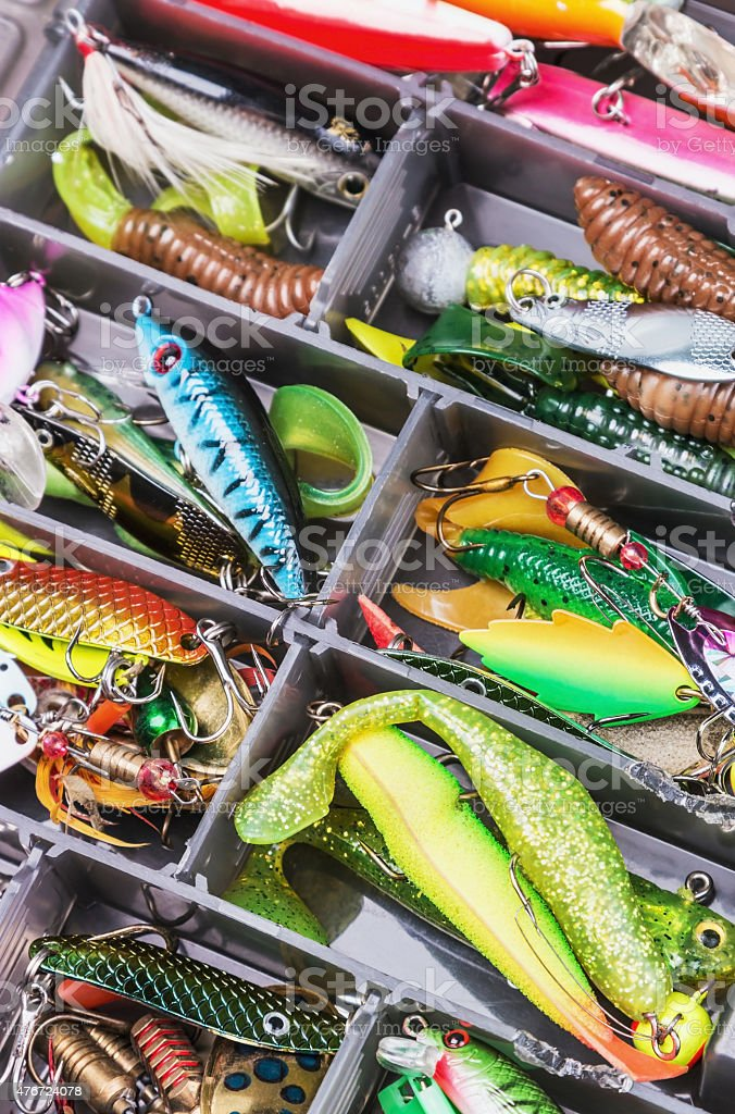 fishing lures and accessories in the box background stock photo