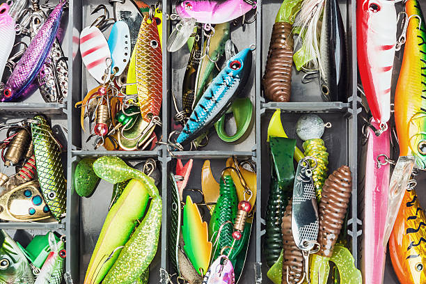 fishing lures and accessories in the box fishing lures and accessories in the box background fishing bait stock pictures, royalty-free photos & images
