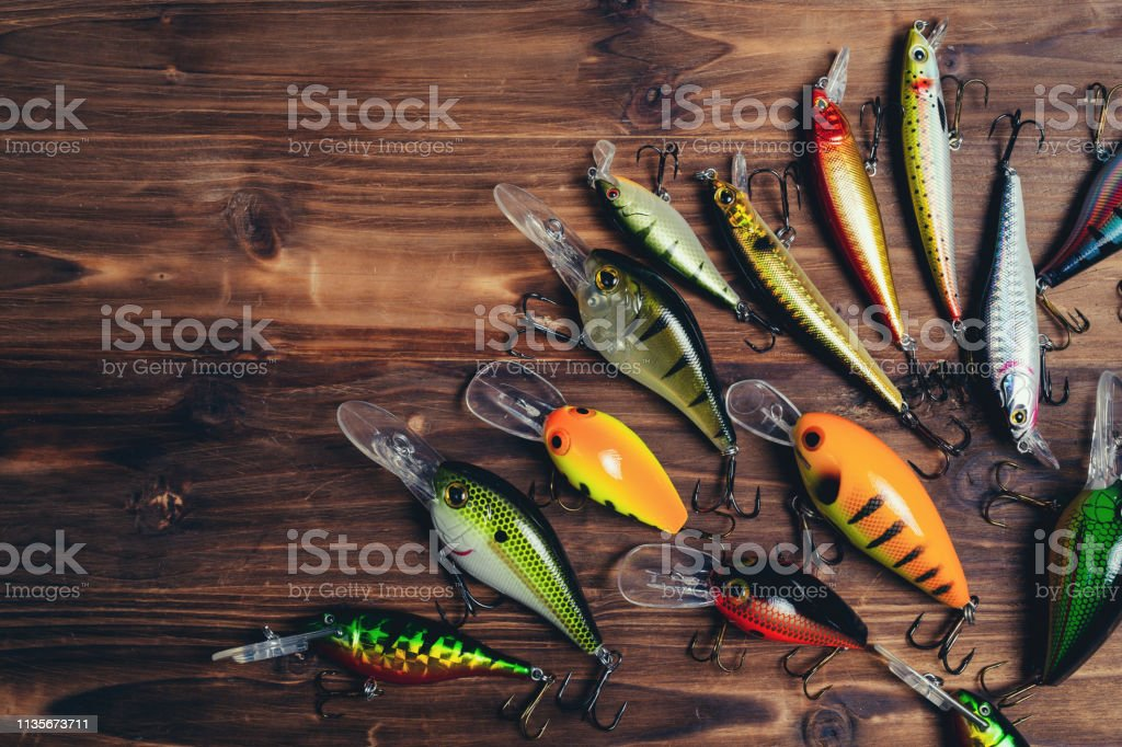 Fishing Lures On A Wooden Background Stock Photo - Download