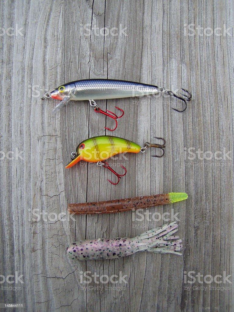 Fishing lures on weathered wood royalty-free stock photo