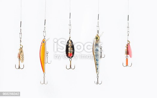 istock Fishing lures on white background. 955256342