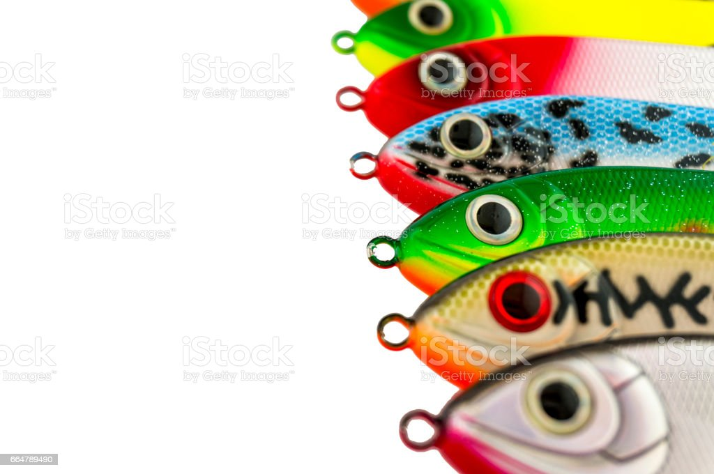 Fishing lures standing in a row. stock photo