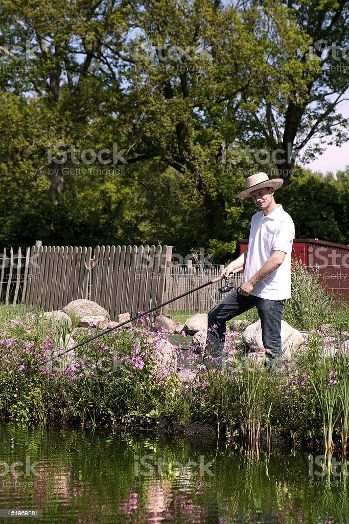 Fishing man at the pond stock photo