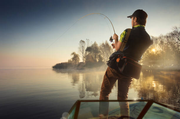 Fishing. Man fishing on a lake on boat Fishing fisherman stock pictures, royalty-free photos & images