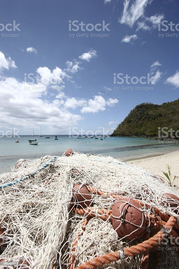 Fishing net and tropical background royalty-free stock photo