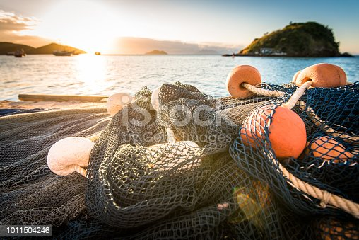 Fishing Nets With Floats at the Beach by Sunset.