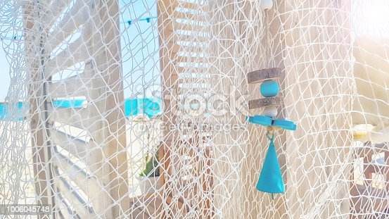 699960484istockphoto Fishing net on a tropical beach background 1006045748