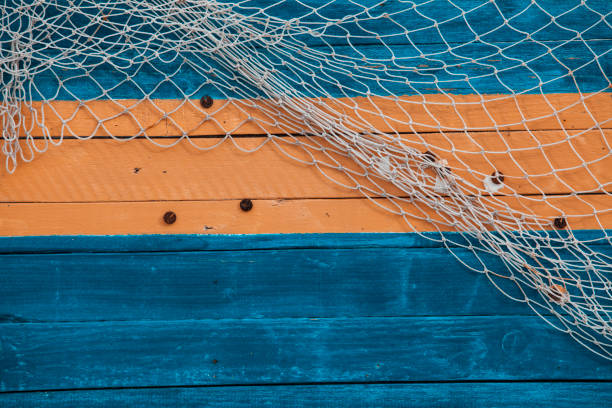 Fishing net on the board Fishing net on the board fishing net stock pictures, royalty-free photos & images