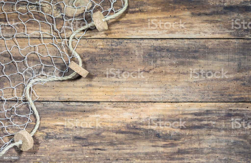 Fishing net over rustic wooden background stock photo