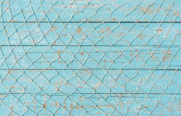 Fishing net over turquoise wooden background stock photo