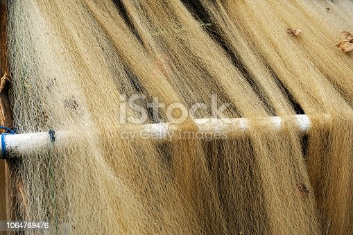 Close-up at texture of thin rustic fishing nets drying outdoor.