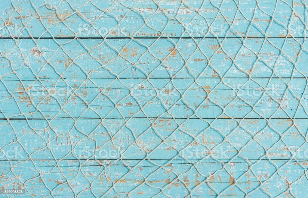 Pêche de texture net sur bois bleu clair, fond maritime photo libre de droits