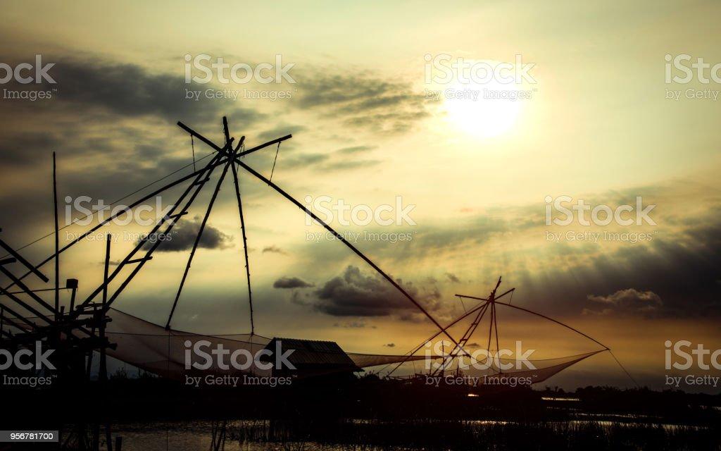 Fishing net with sunset background stock photo