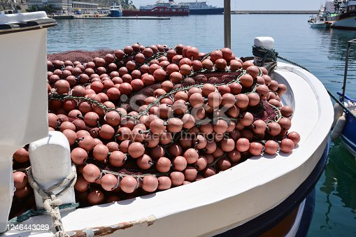 Fishing nets and buoys on board a fishing boat in the port of Kavala, Greece.