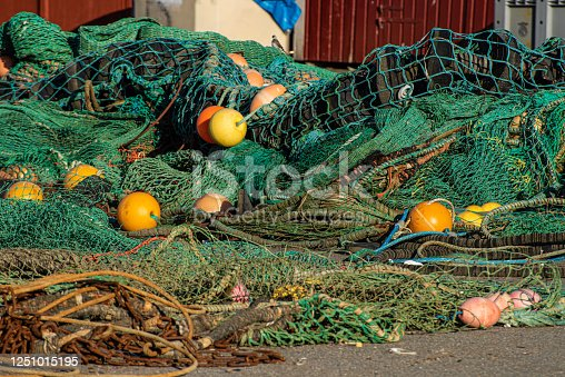 istock Fishing nets and trawls on the ground 1251015195