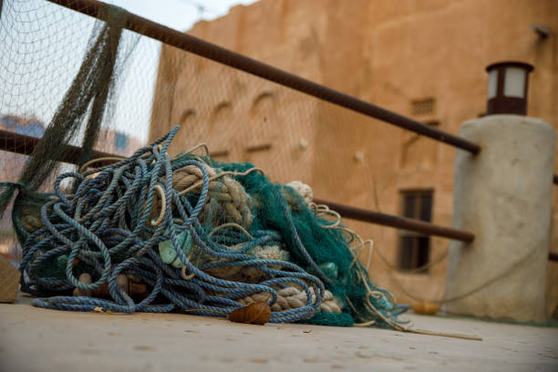 Fishing nets, buoys and floats on pavement not being used in old town Dubai stock photo