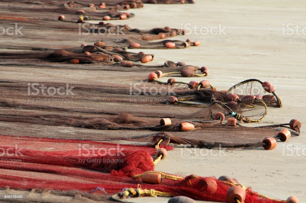 fishing nets drying on the sand coast of  Indian Ocean foto