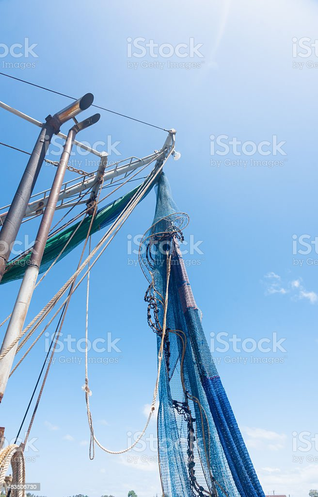 Fishing nets hanging and drying in sun stock photo