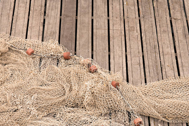 Fishing nets on pier stock photo