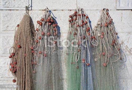 Fishing nets hang to dry.