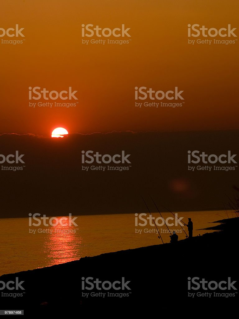 Fishing on a Red Sunset royalty-free stock photo