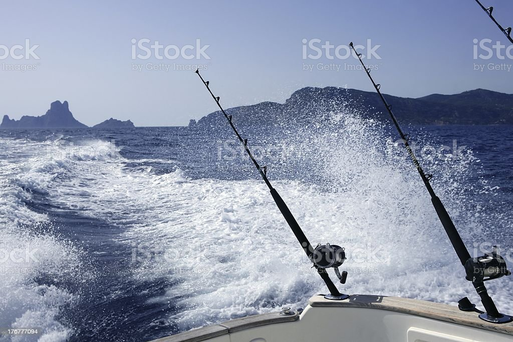 Fishing on boat with rods and reels in Mediterranean royalty-free stock photo