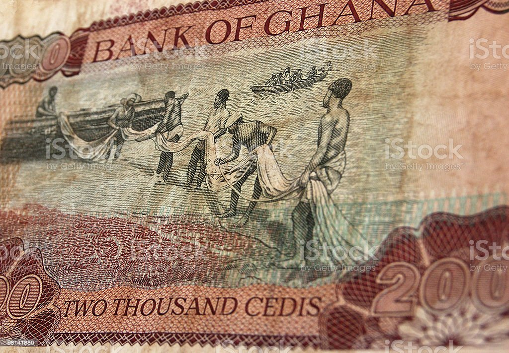 Fishing on Ghana banknote royalty-free stock photo