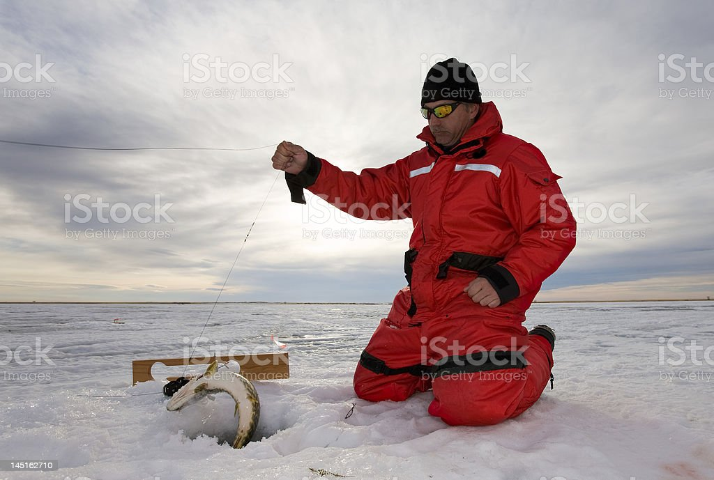 Fishing on ice stock photo