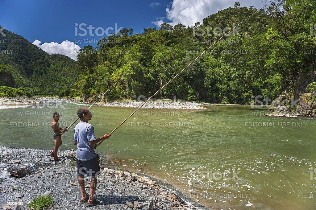 Fishing on Kameng river, Arunachal Pradesh, India. stock photo
