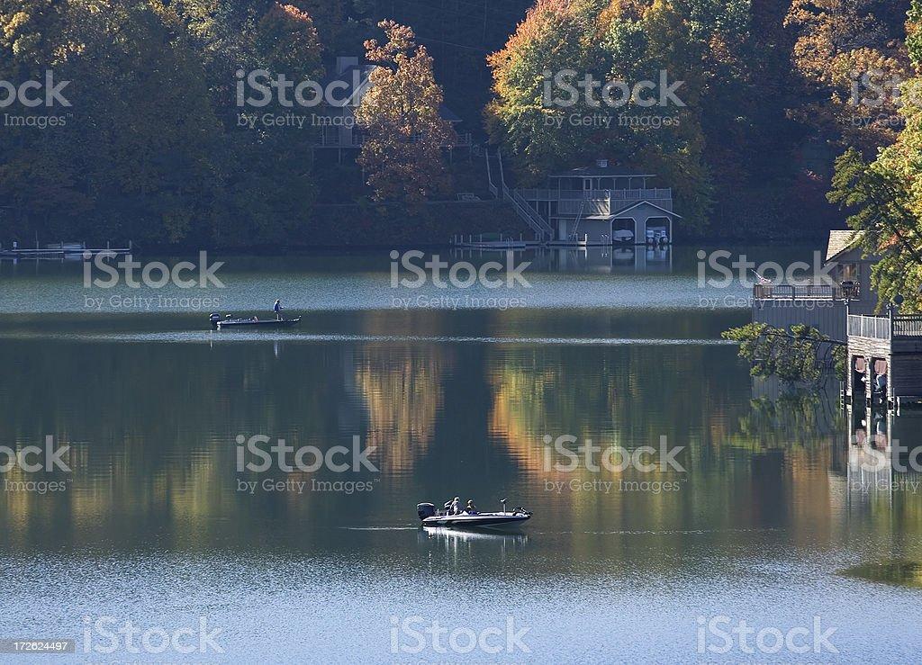 Fishing on lake in fall stock photo