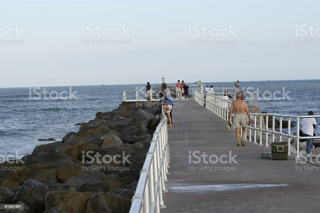 Fishing on the Jetty stock photo