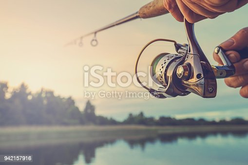 istock Fishing on the lake at sunset. Fishing background. 942157916