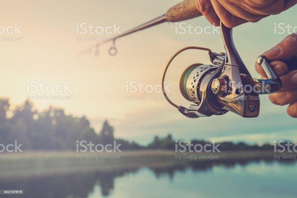 Fishing on the lake at sunset. Fishing background. stock photo