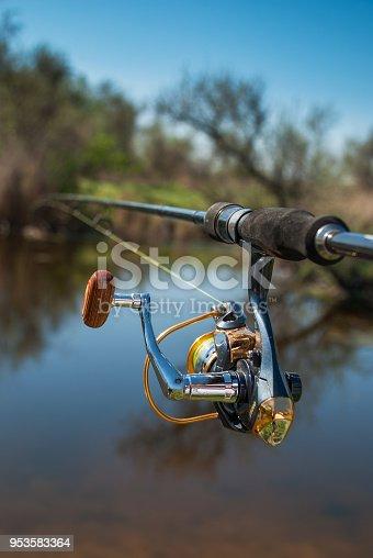 951984746istockphoto Fishing on the lake at sunset. Fishing background. 953583364