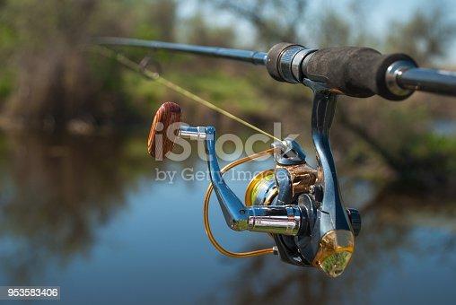 951984746istockphoto Fishing on the lake at sunset. Fishing background. 953583406