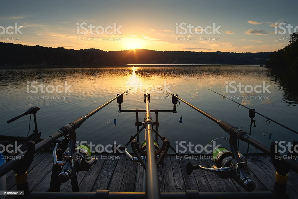 Fishing on the lake sunset stock photo