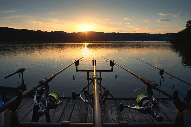 Fishing on the lake sunset stock photo